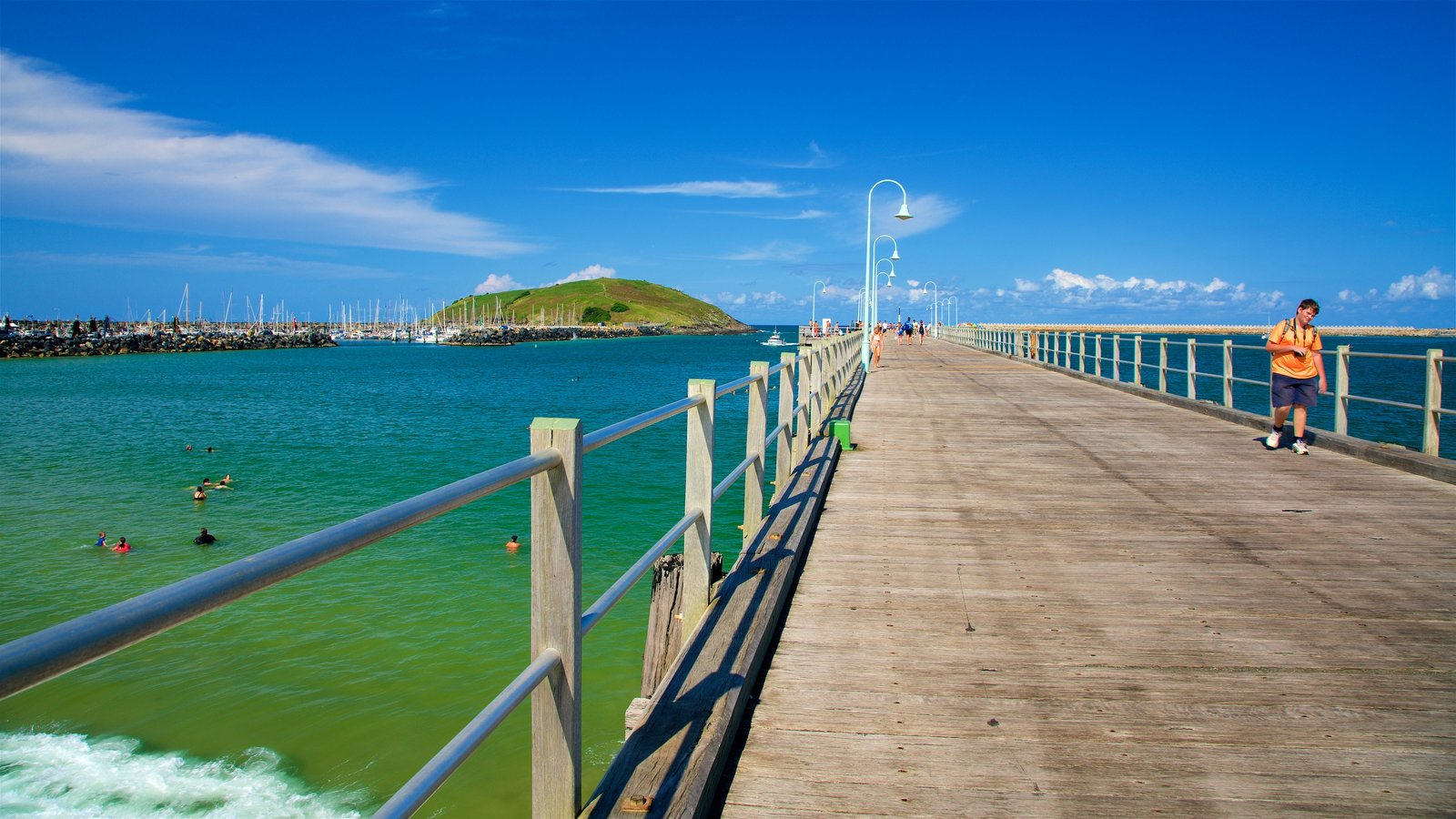Coffs Harbour which includes swimming and general coastal views as well as a small group of people