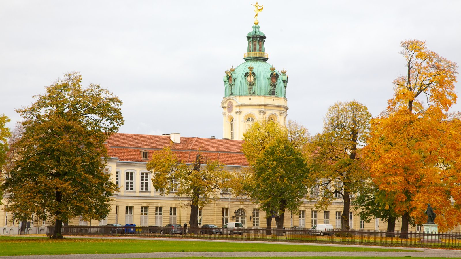 Schloss Charlottenburg featuring a castle, heritage architecture and autumn leaves