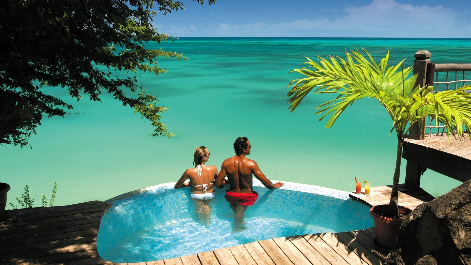 Antigua showing swimming, a luxury hotel or resort and general coastal views