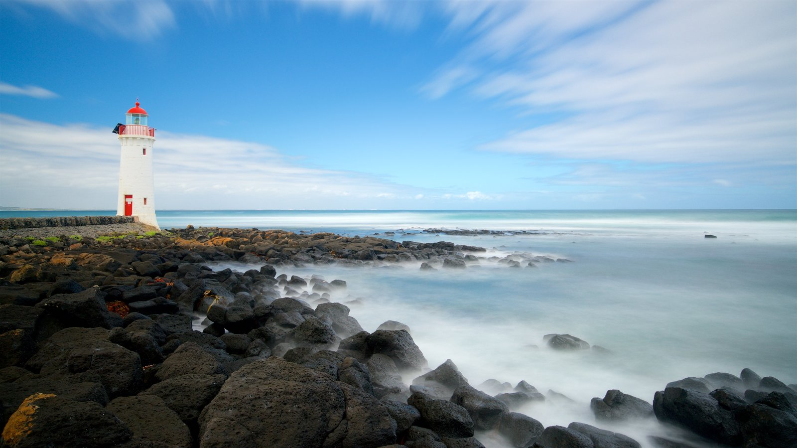 Victoria showing rocky coastline, a lighthouse and general coastal views