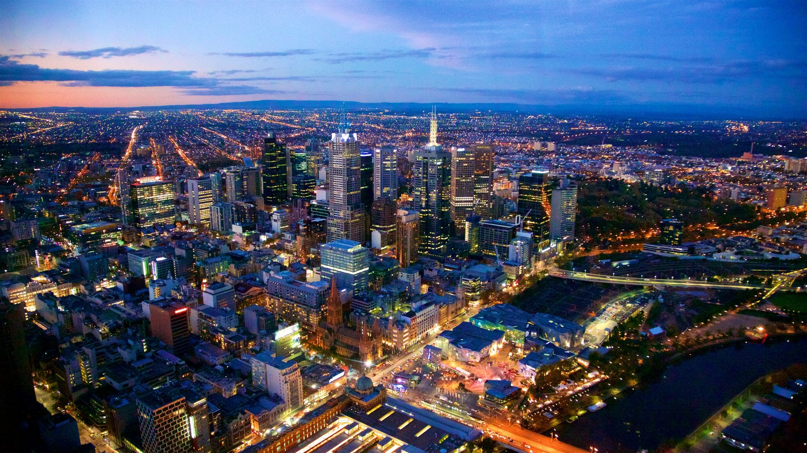 Melbourne showing a city, a sunset and landscape views