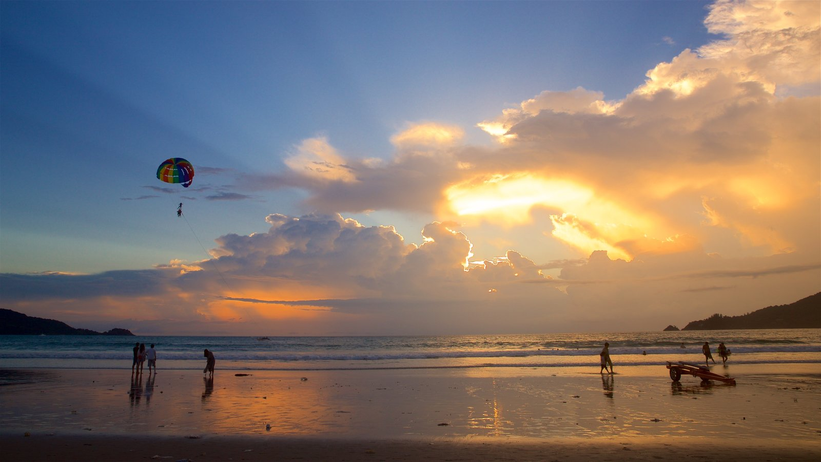 Patong showing a sunset, general coastal views and a beach