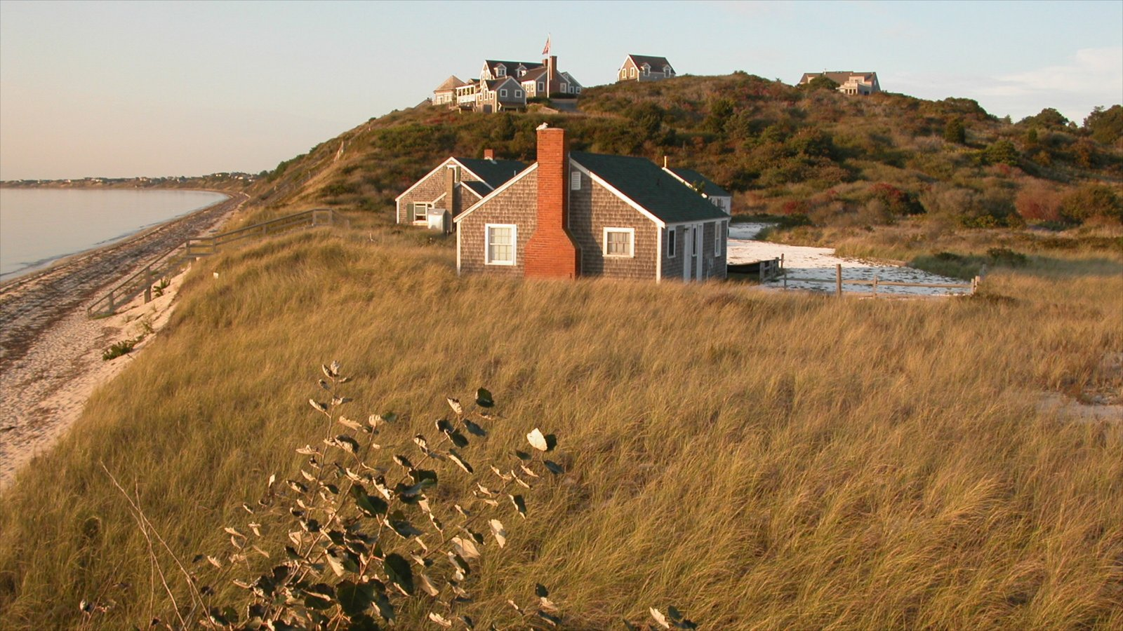 Cape Cod showing a sunset, a house and general coastal views