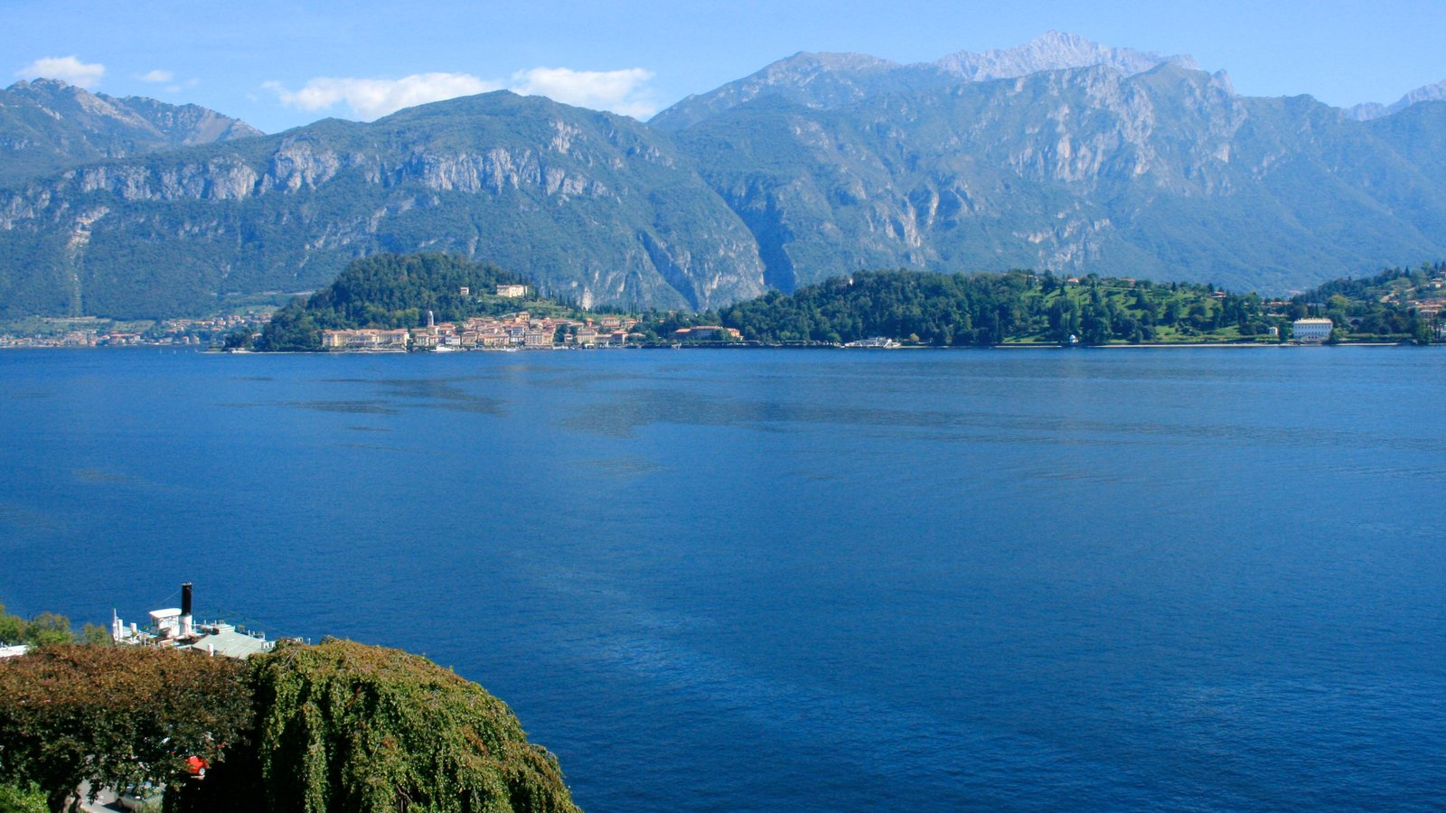 Como which includes a lake or waterhole, landscape views and mountains