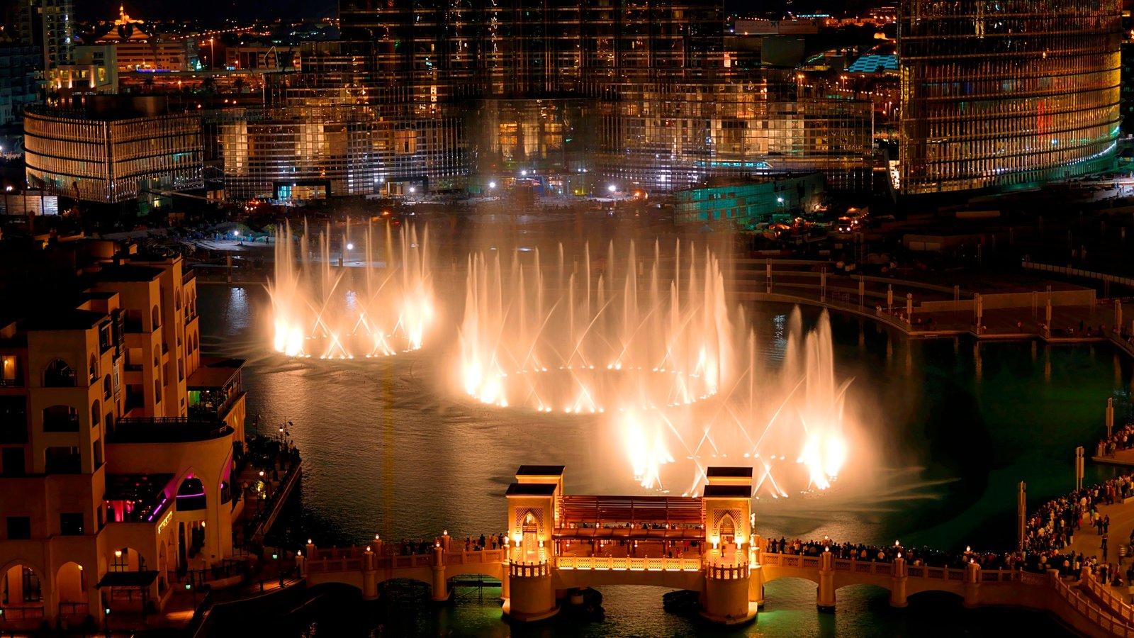 The Dubai Fountain which includes a bridge, night scenes and cbd
