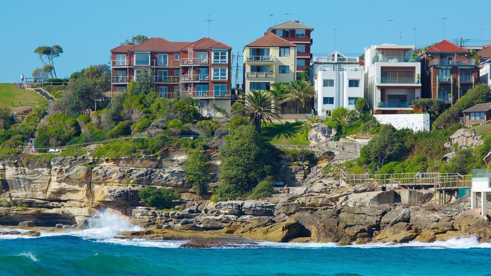 Sydney showing rugged coastline and a coastal town