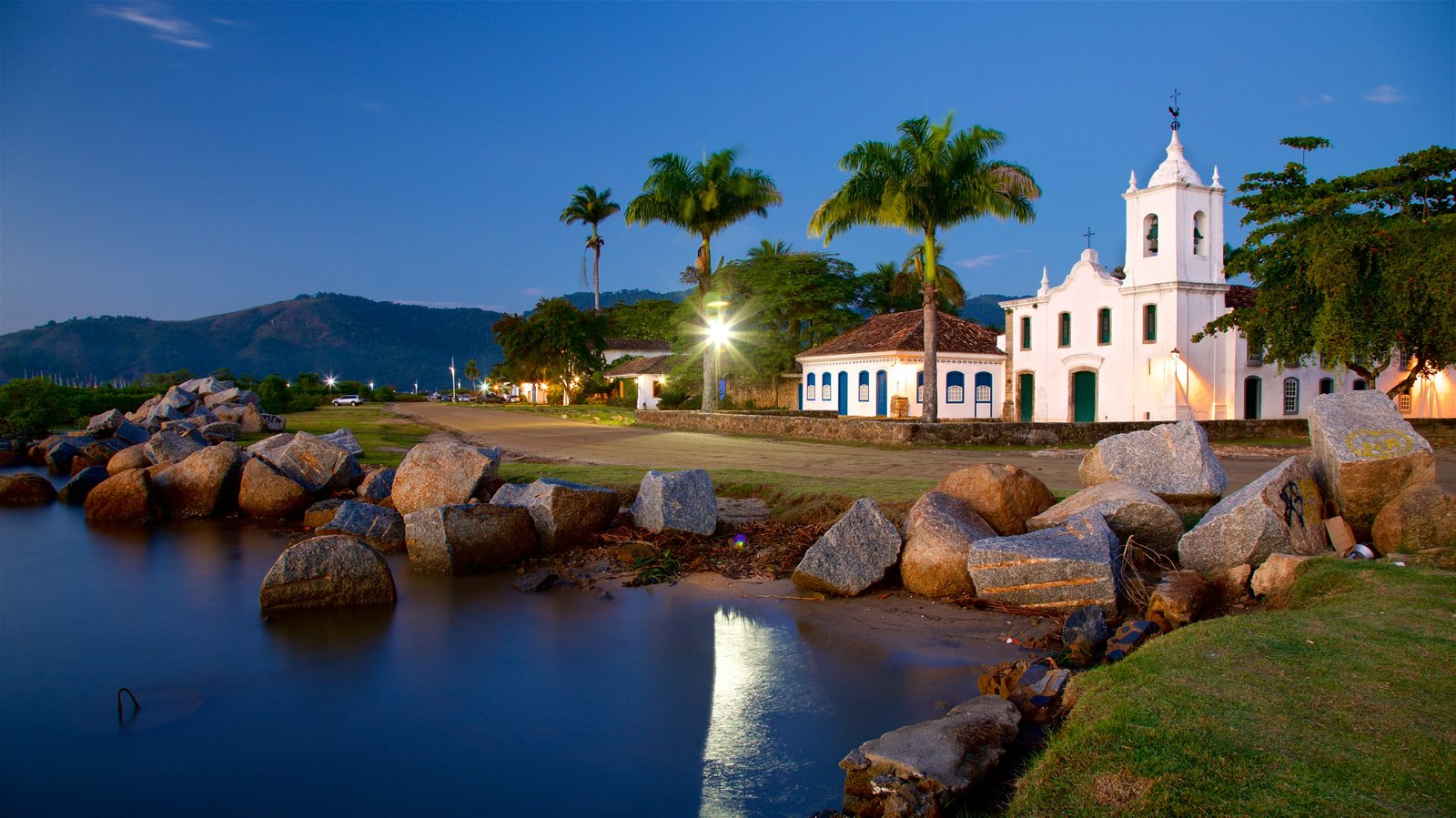 Nossa Senhora das Dores Church showing night scenes, a lake or waterhole and a small town or village