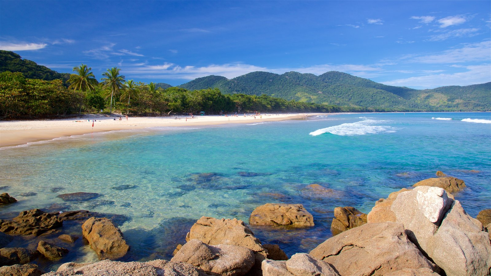Lopes Mendes Beach featuring a beach, rocky coastline and tropical scenes
