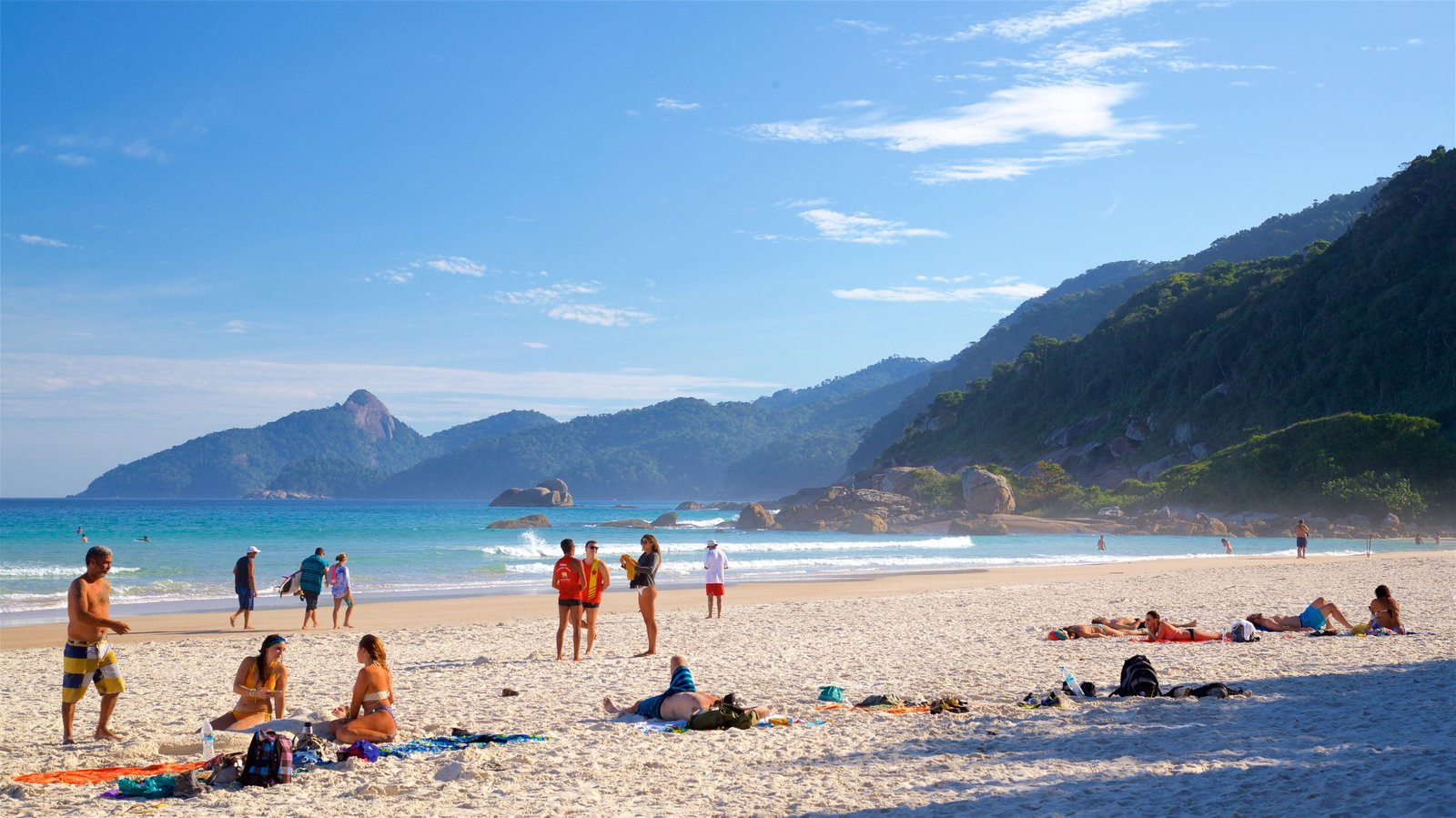 Lopes Mendes Beach which includes general coastal views and a sandy beach as well as a small group of people