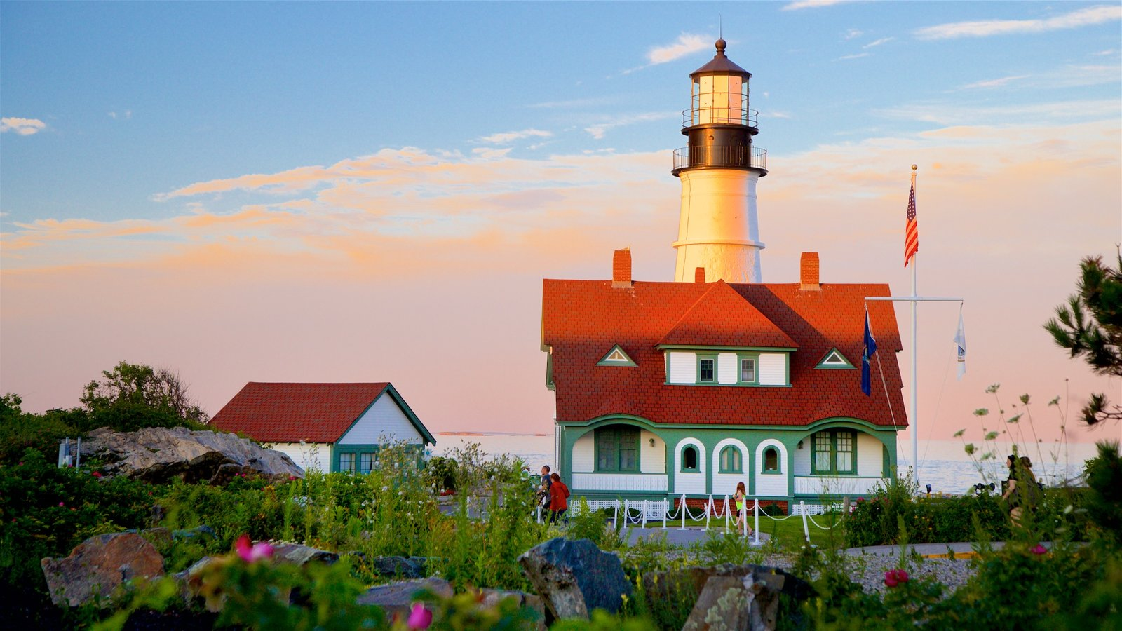 Portland Head Light showing a lighthouse and a sunset