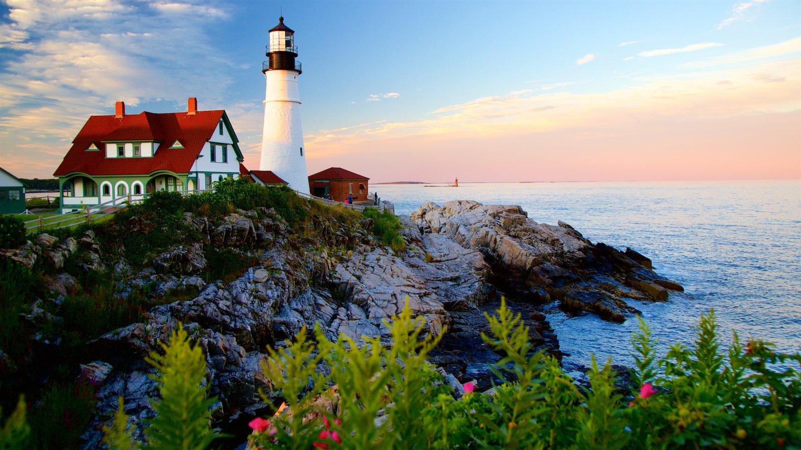 Portland Head Light featuring a lighthouse, rocky coastline and a sunset