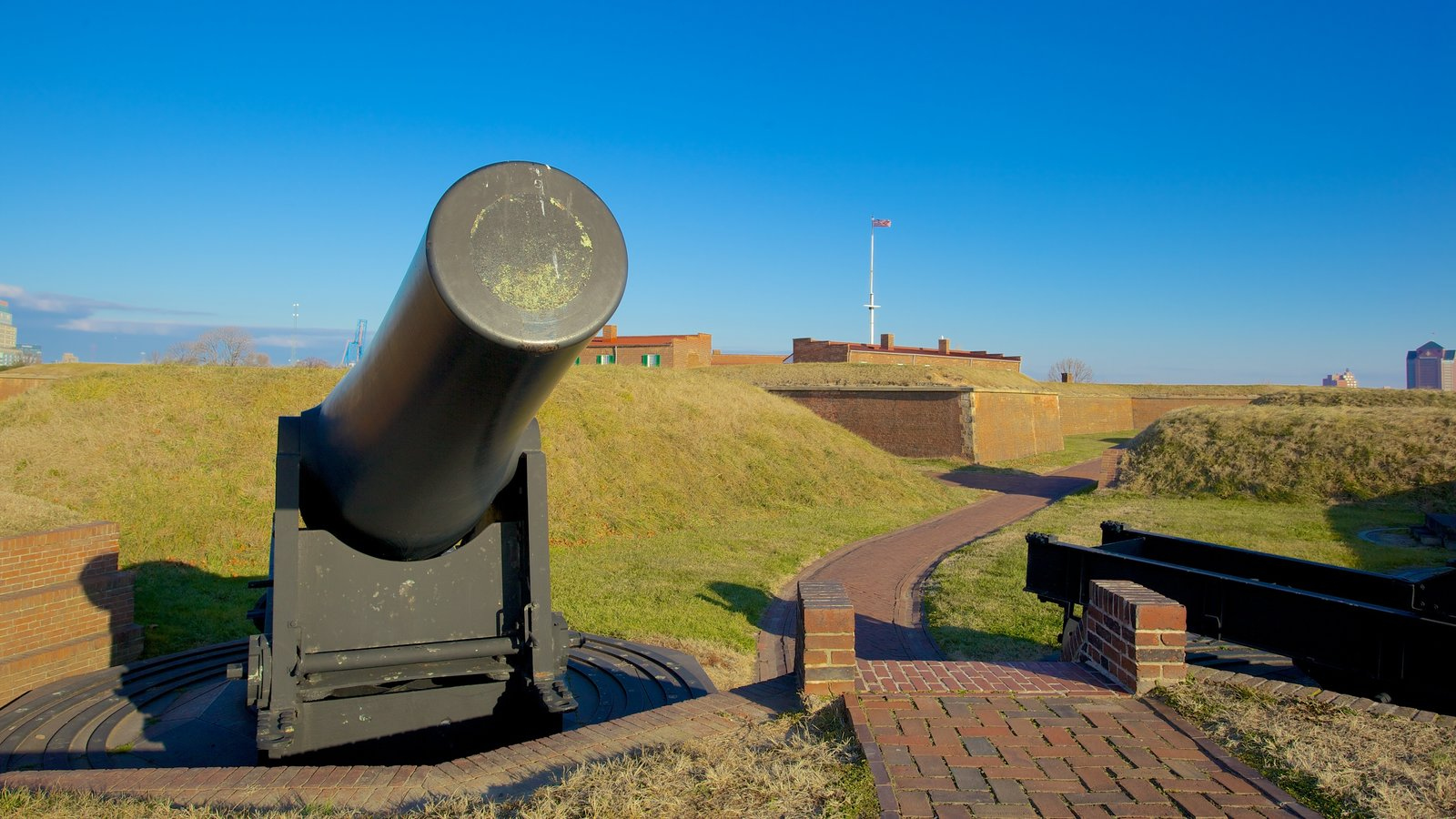 Fort McHenry featuring military items and a monument