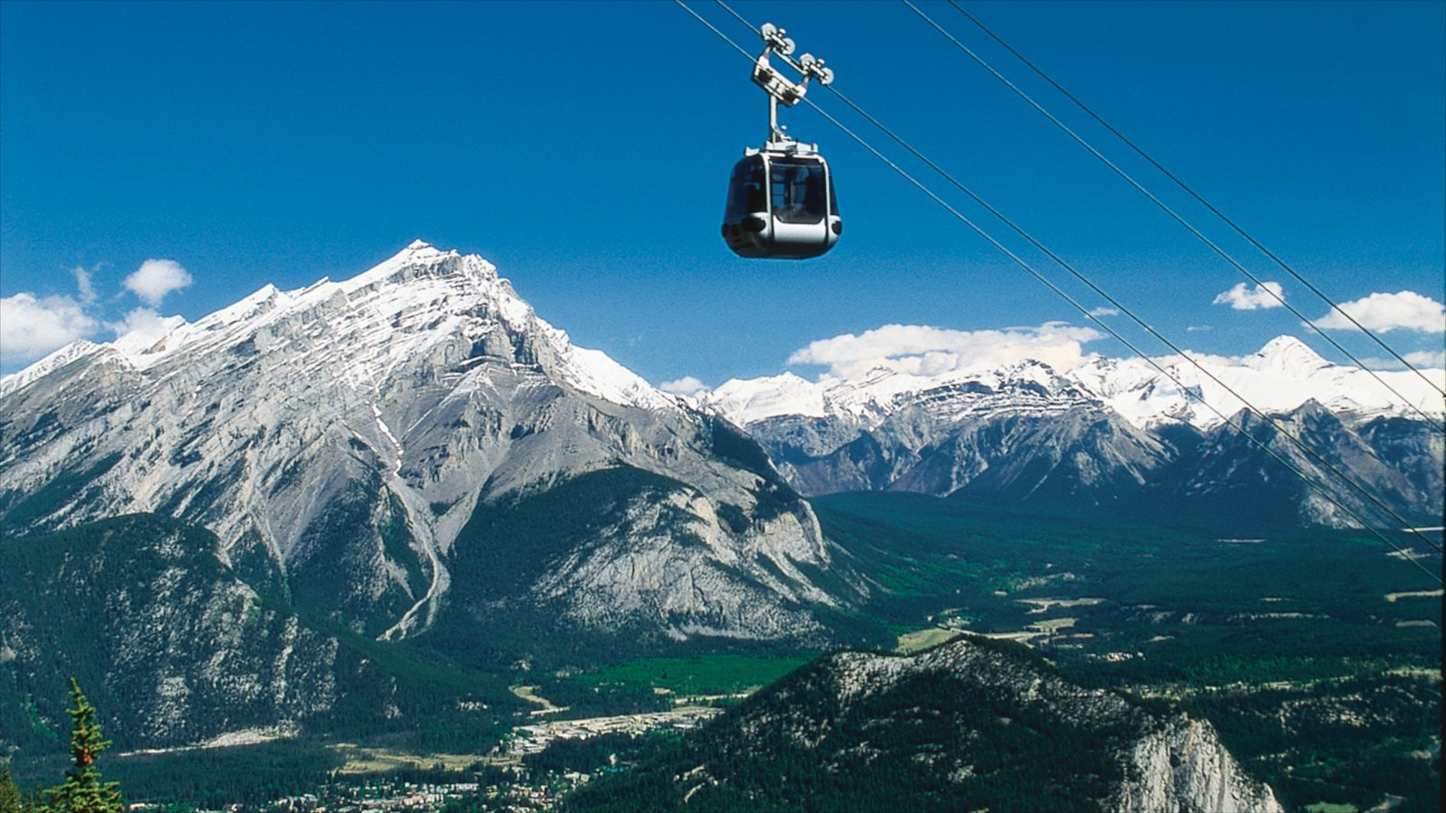 Banff Gondola showing mountains, snow and a gondola