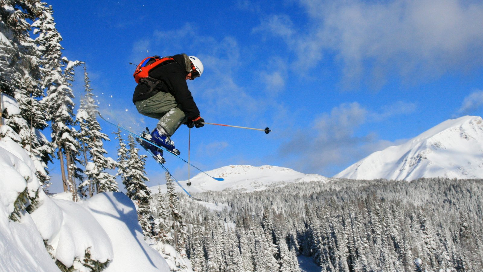 Sunshine Village which includes landscape views, snow and a sporting event