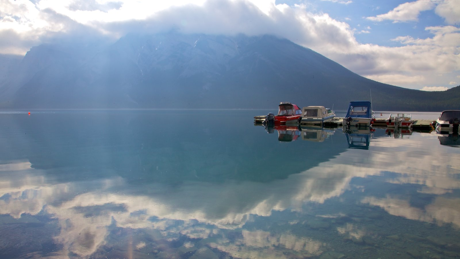 Lake Minnewanka showing boating, a marina and a bay or harbour