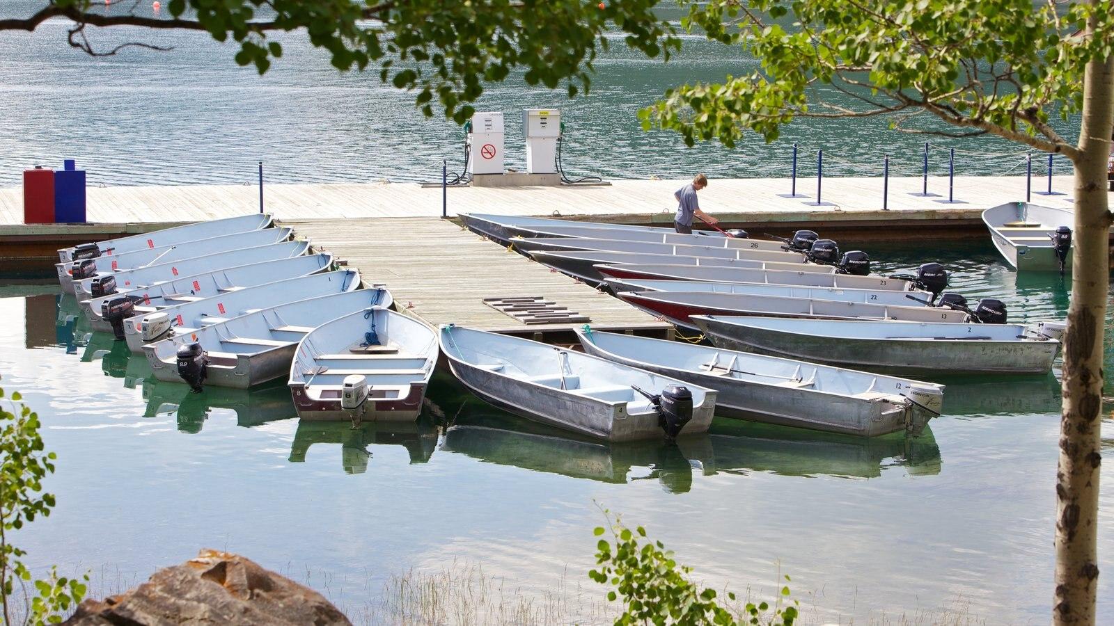 Lake Minnewanka showing boating and a lake or waterhole
