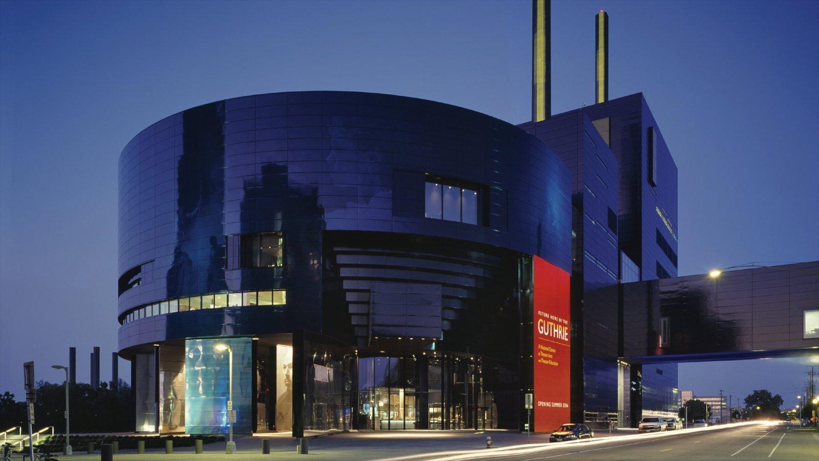 Teatro Guthrie caracterizando cenas noturnas, arquitetura moderna e uma cidade