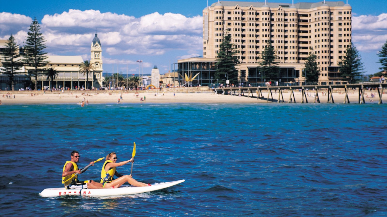 Glenelg Beach featuring a beach, a luxury hotel or resort and kayaking or canoeing