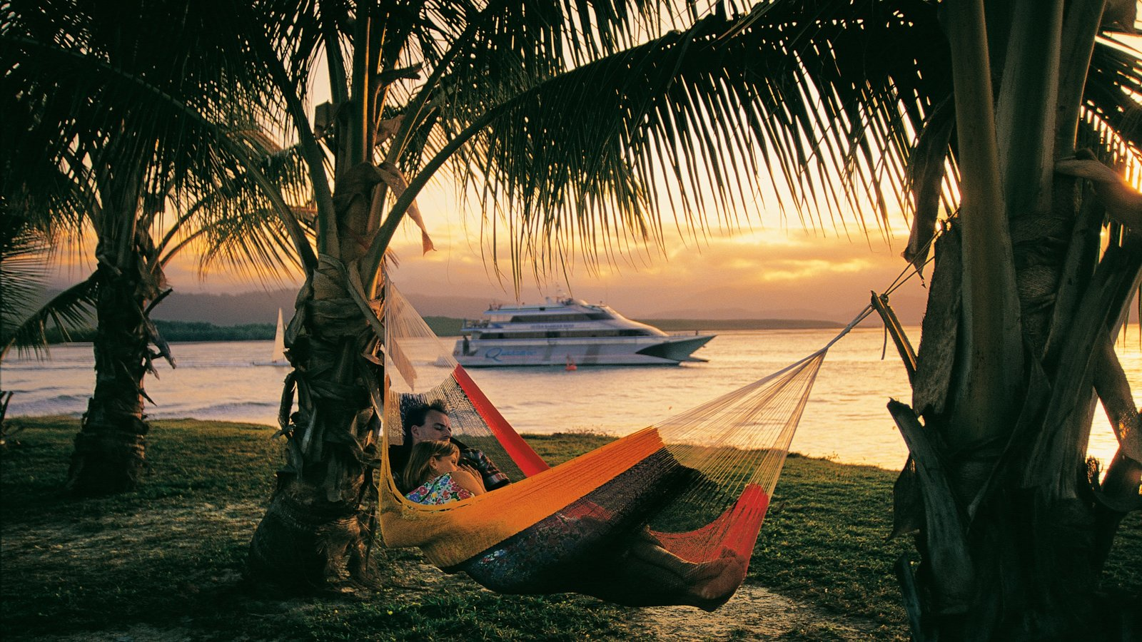 Port Douglas which includes tropical scenes, a sunset and boating