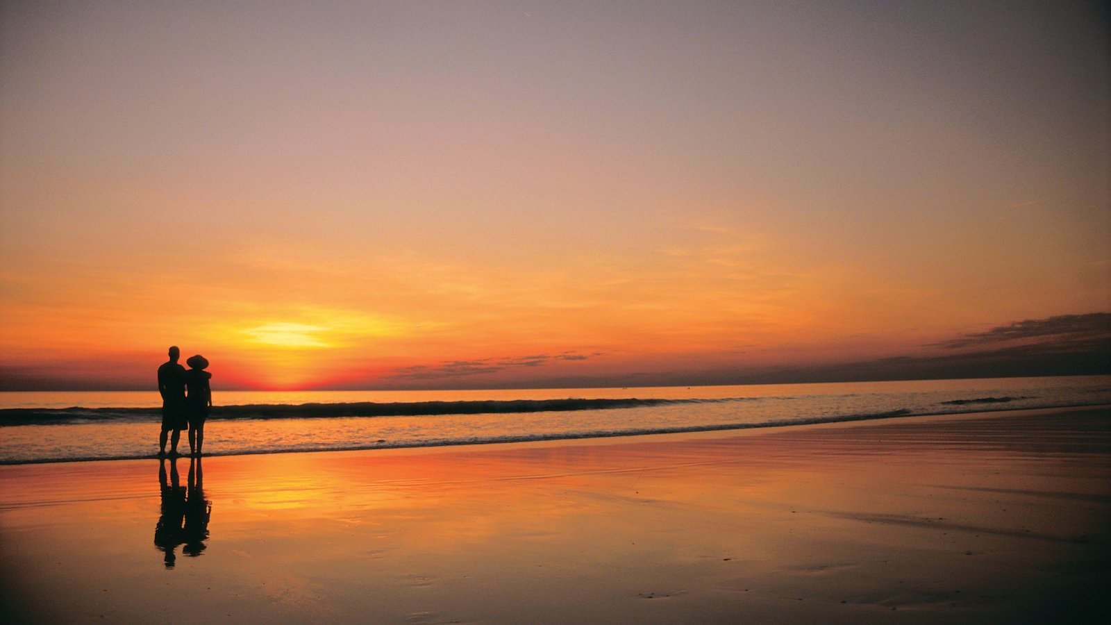 Broome which includes a sandy beach, landscape views and a sunset