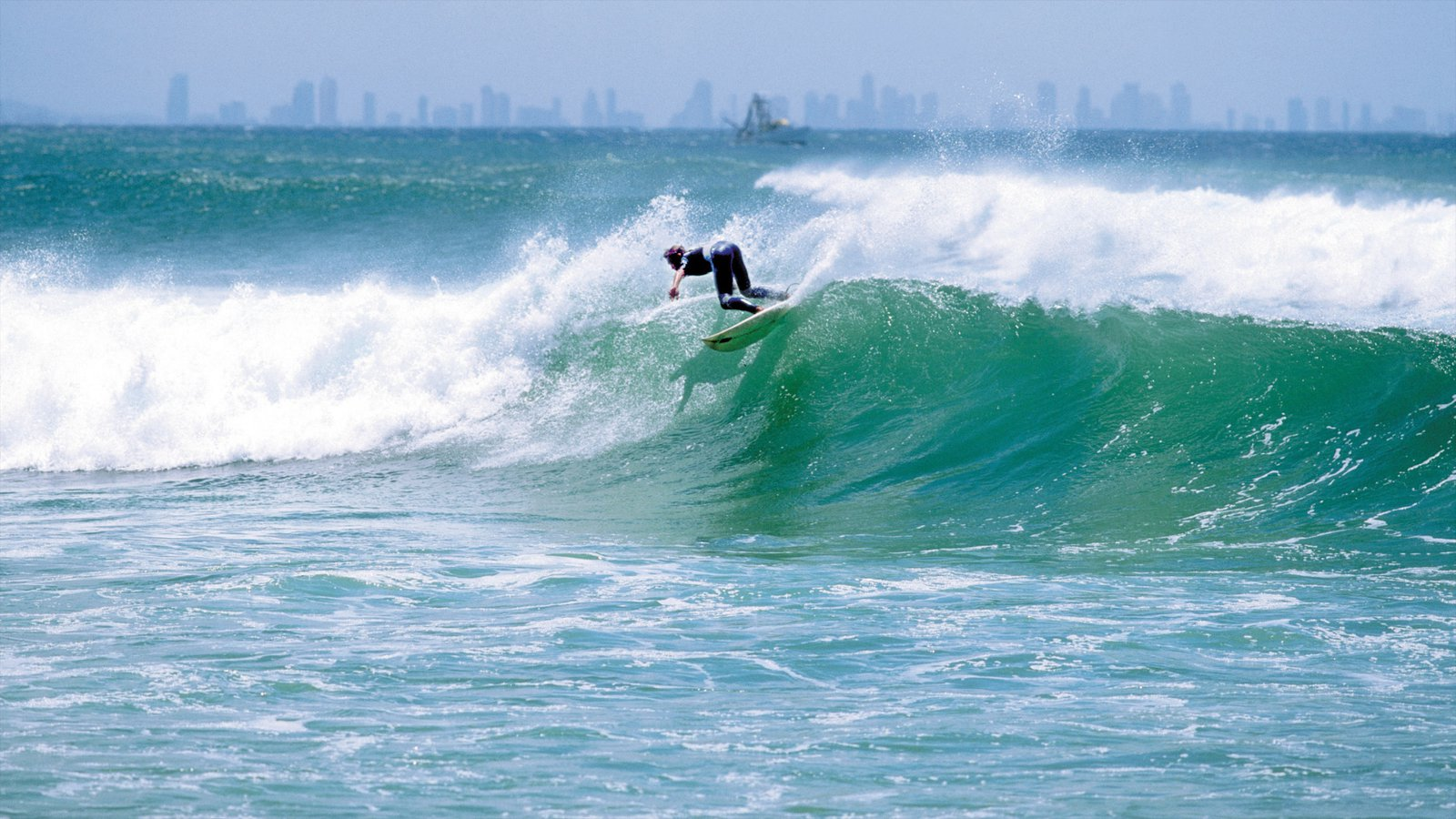 Coolangatta Beach featuring surf and surfing as well as an individual male