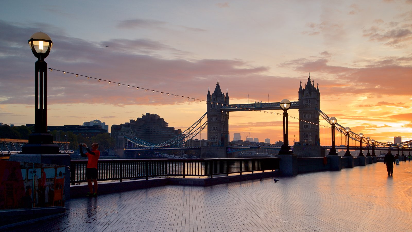 Tower Bridge which includes a bridge, a sunset and landscape views