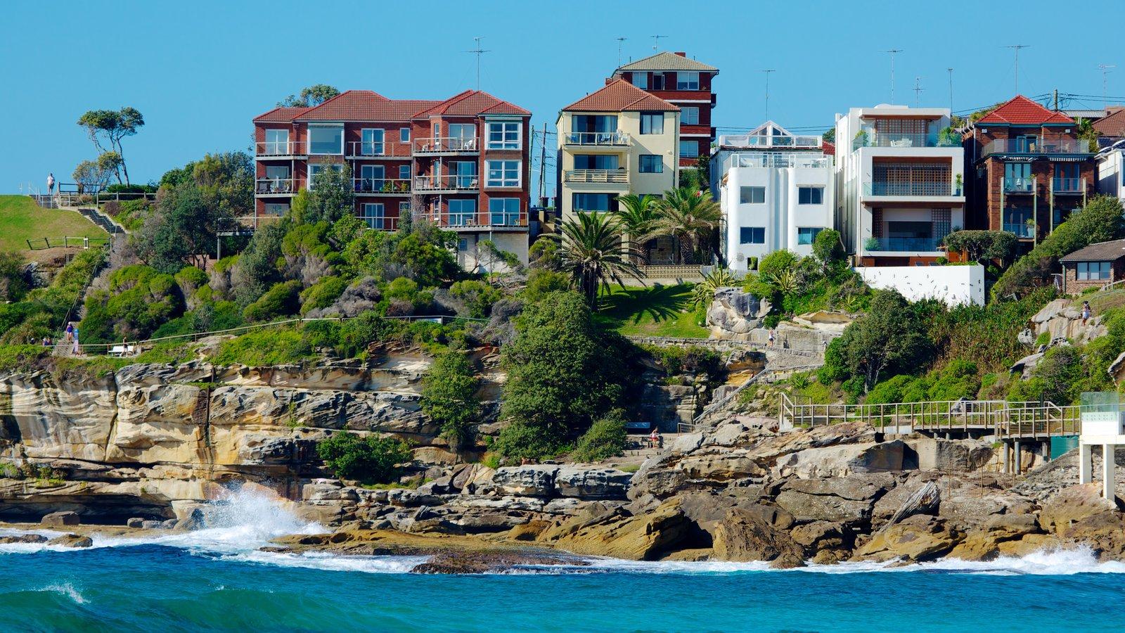 Bondi Beach showing rocky coastline, a house and a coastal town