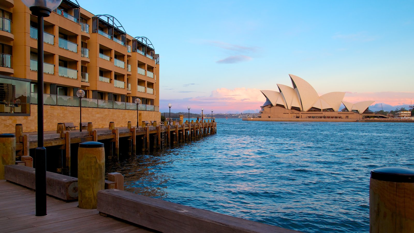 Sydney Opera House showing modern architecture and a bay or harbor