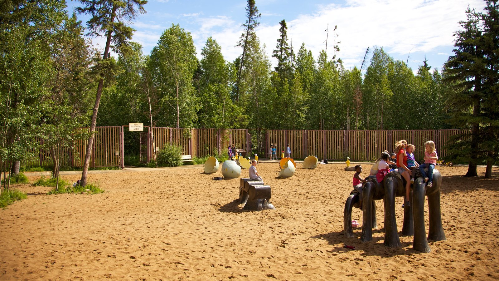 Jurassic Forest featuring a playground and a garden as well as children