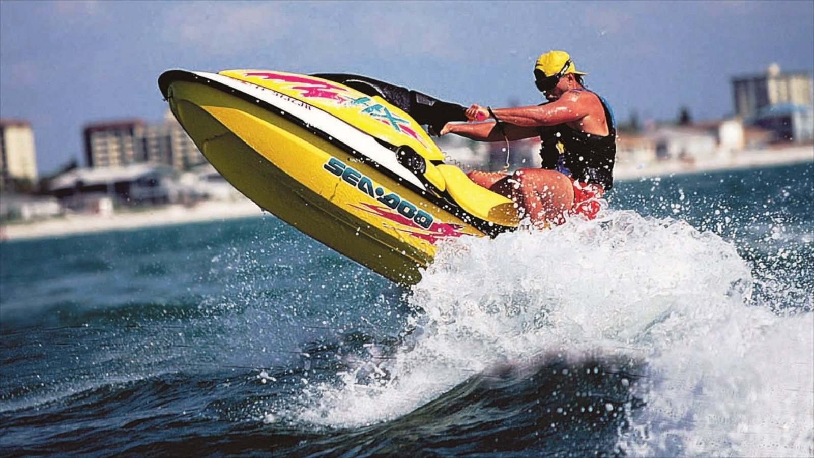 Clearwater Beach which includes waves and jet skiing as well as an individual male