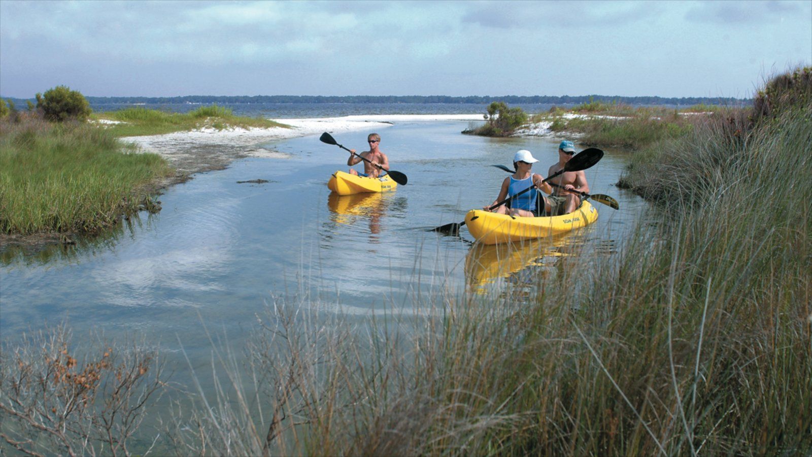 Pensacola Beach which includes a sandy beach, general coastal views and kayaking or canoeing