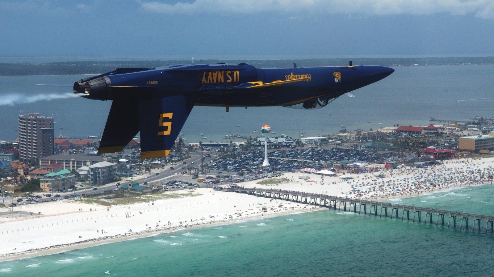 Pensacola Beach showing a sandy beach, an aircraft and tropical scenes