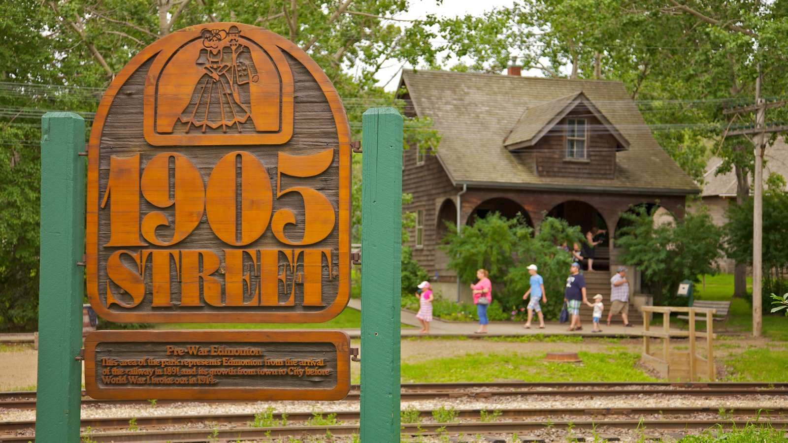 Fort Edmonton Park featuring a park, a house and signage
