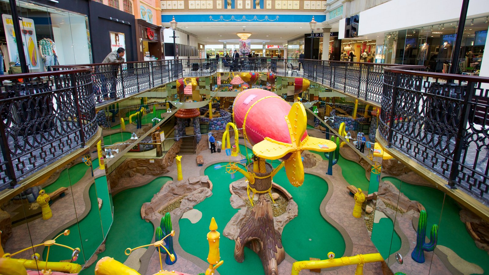 West Edmonton Mall which includes shopping, a playground and interior views