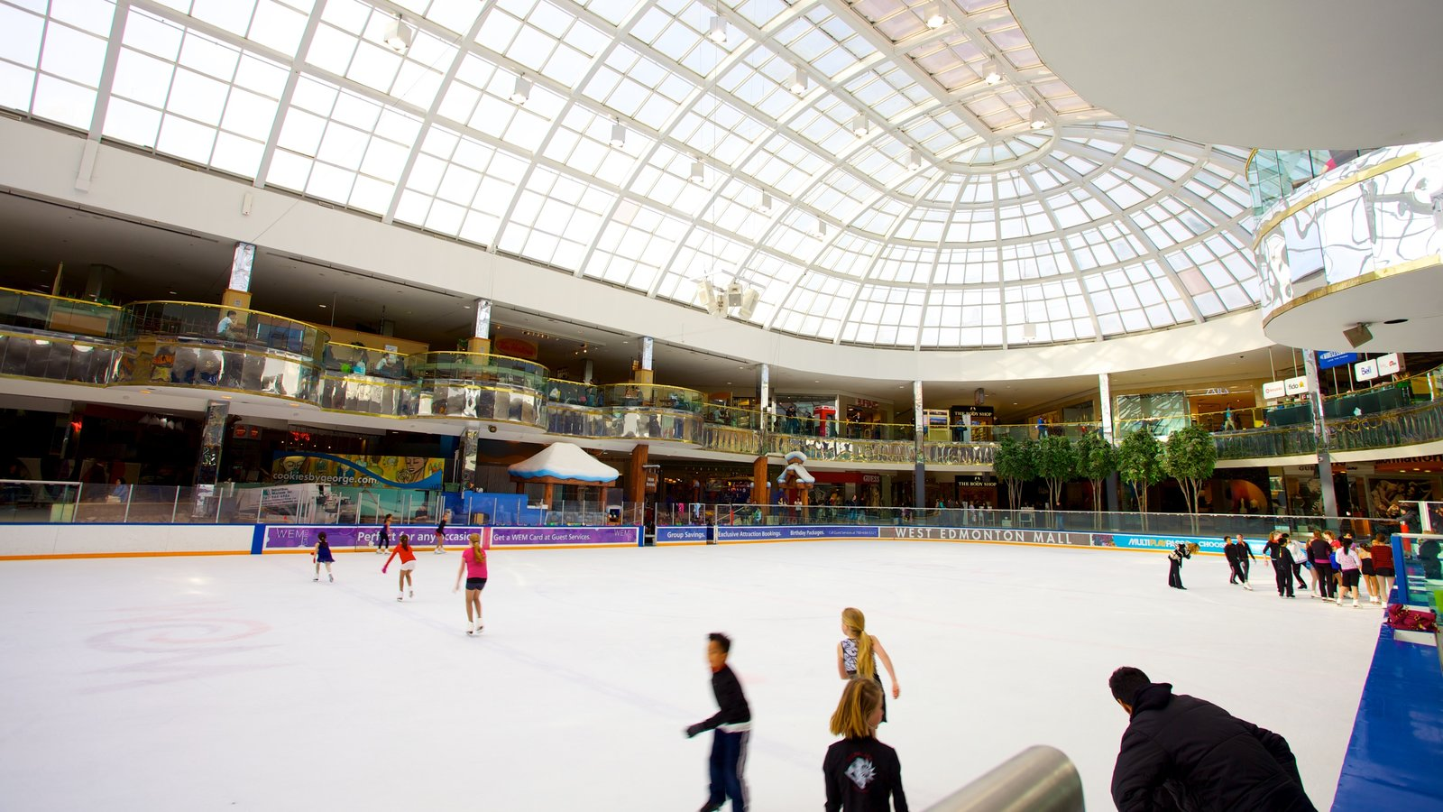 West Edmonton Mall showing modern architecture, interior views and ice skating