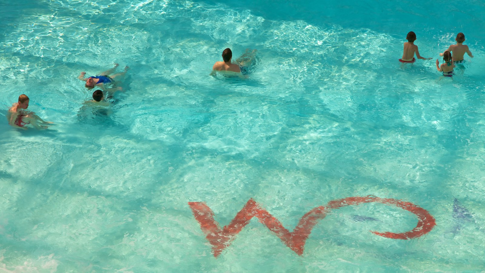 West Edmonton Mall showing swimming, rides and a pool