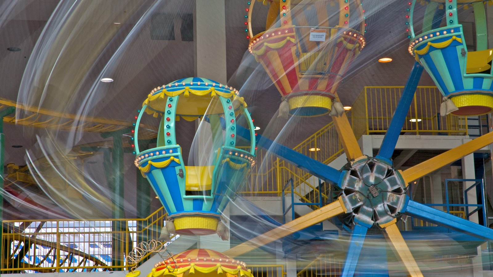 West Edmonton Mall featuring a playground, rides and interior views