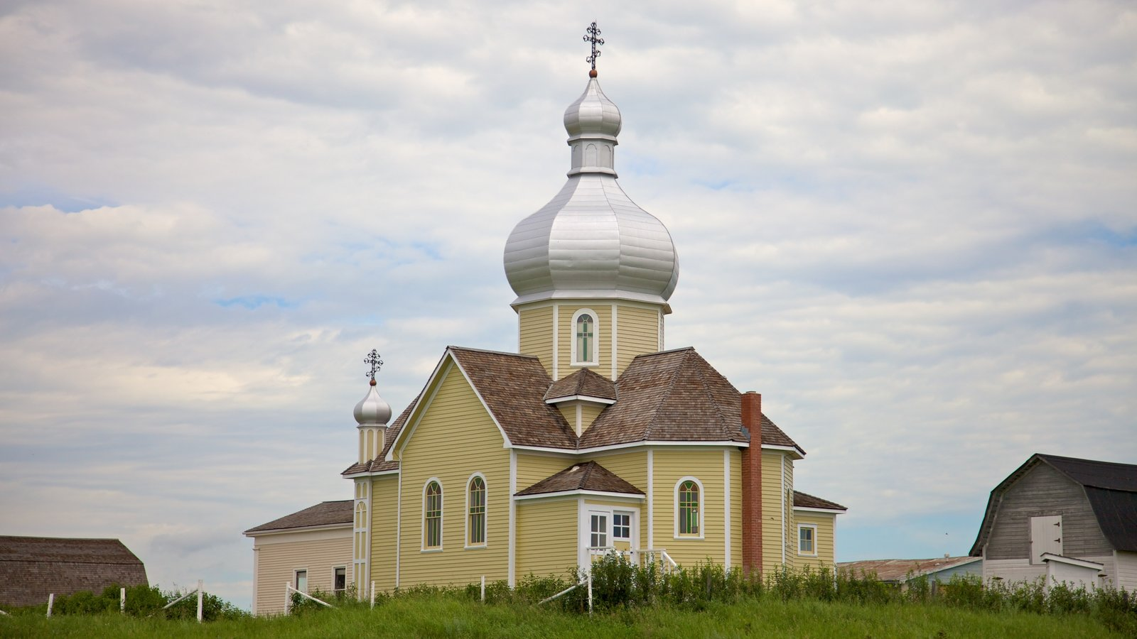 Ukrainian Cultural Heritage Village which includes a small town or village and a church or cathedral