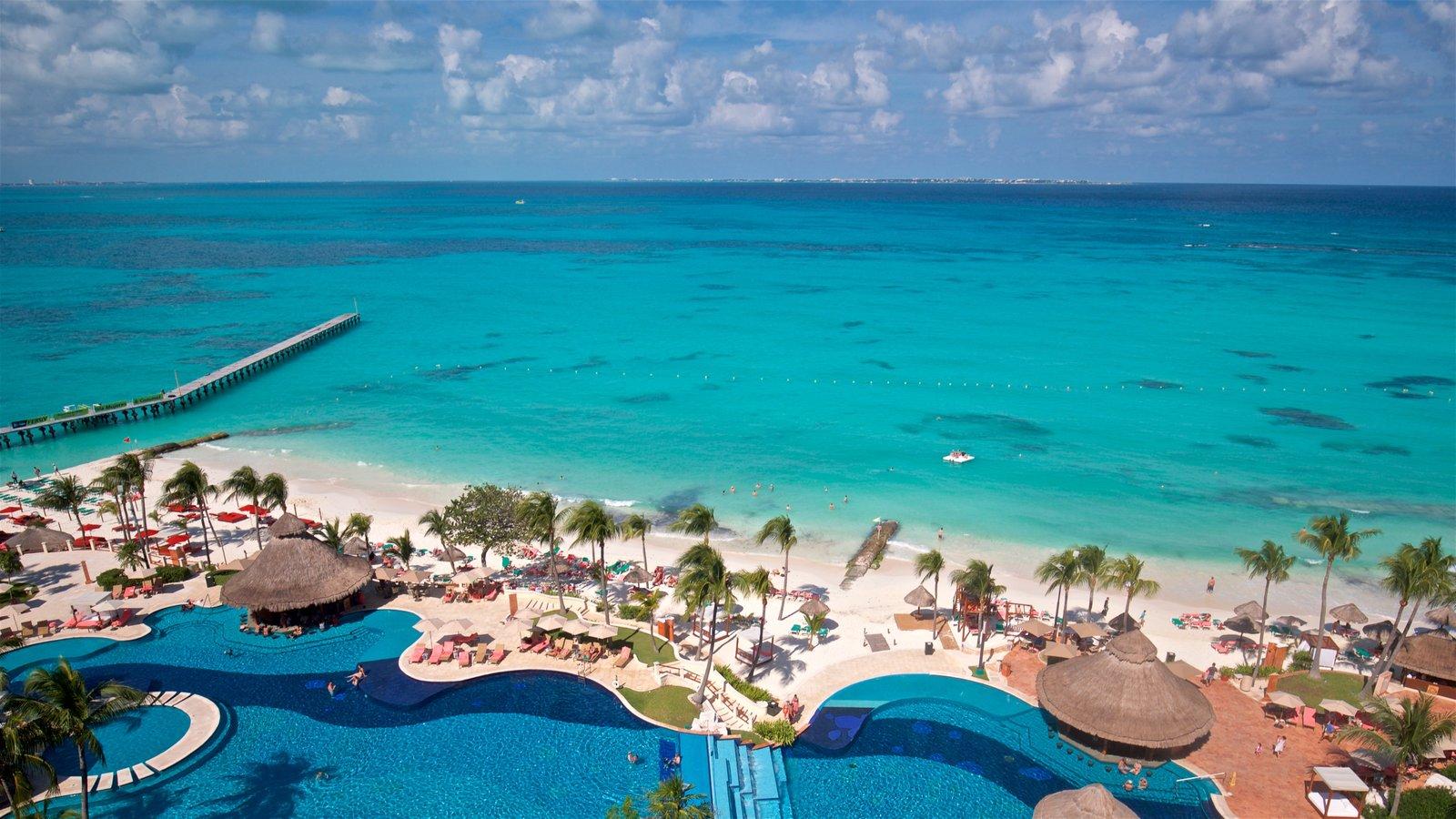 Cancún que incluye escenas tropicales, vistas de paisajes y una alberca