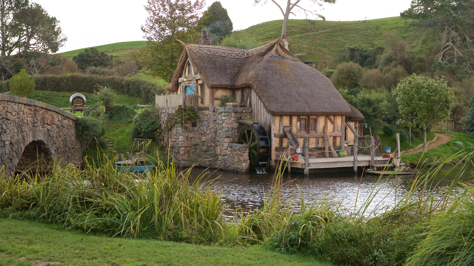 Hobbiton Movie Set which includes a river or creek and a small town or village
