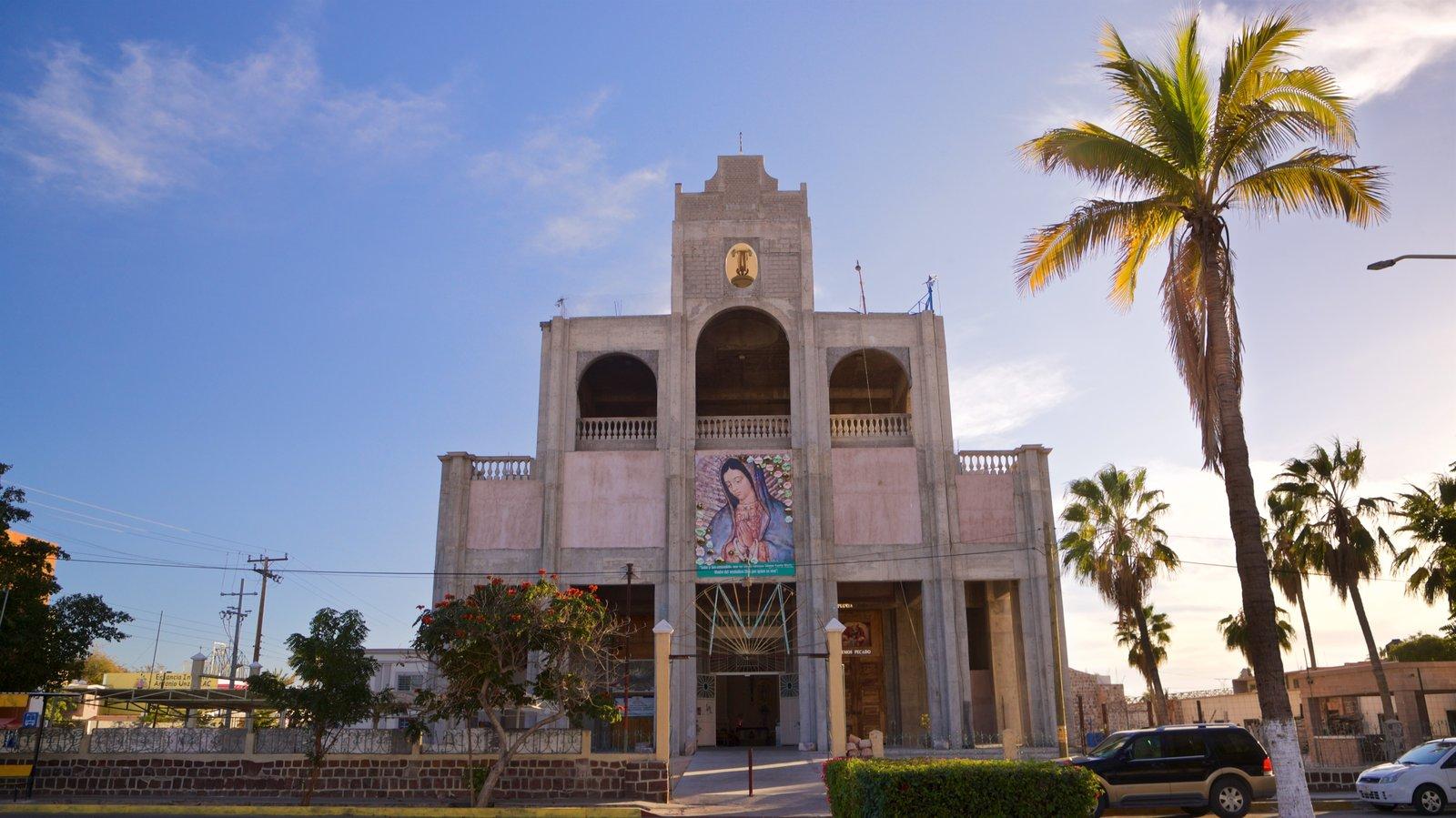 Santuario de la Virgen de Guadalupe mostrando una puesta de sol, una iglesia o catedral y patrimonio de arquitectura