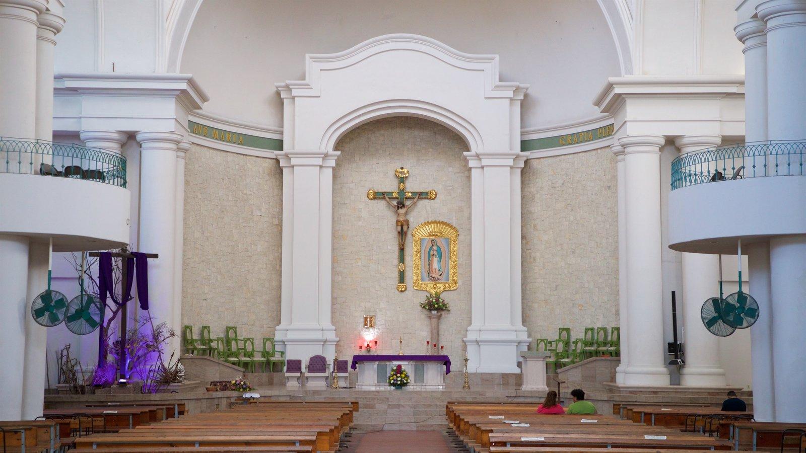 Santuario de la Virgen de Guadalupe que incluye vistas interiores y una iglesia o catedral