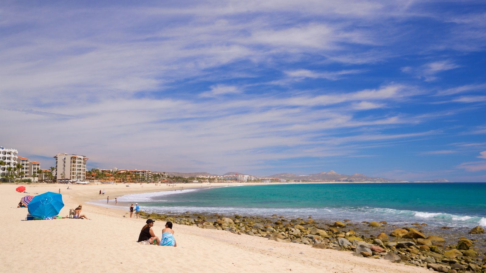 Costa Azul Beach which includes general coastal views and a beach as well as a couple
