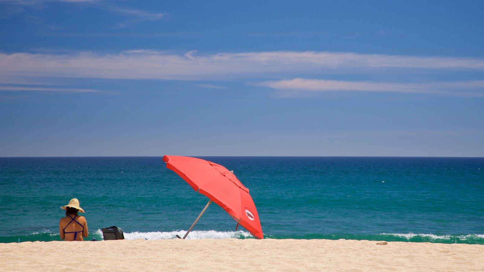 Costa Azul Beach showing a beach and general coastal views as well as an individual femail