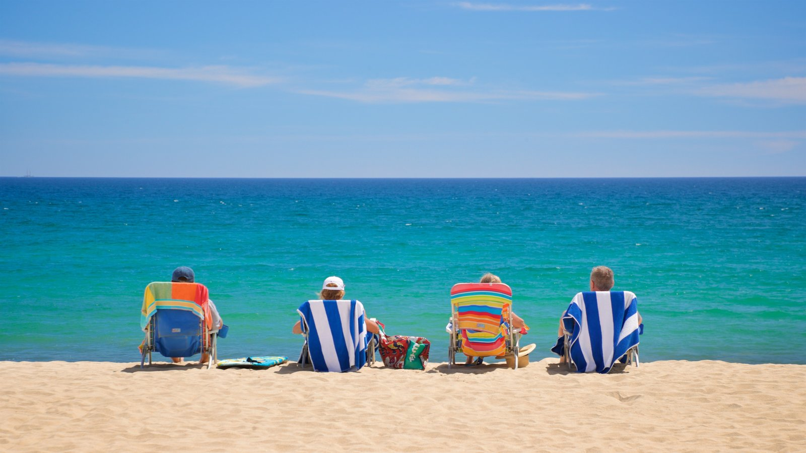 Costa Azul Beach which includes general coastal views and a sandy beach as well as a small group of people