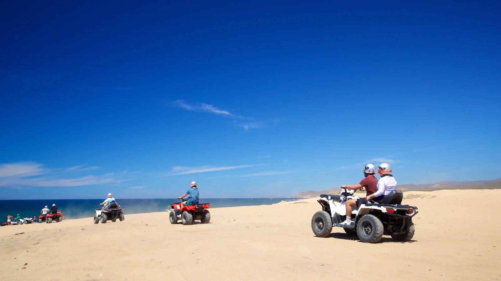 Migrino featuring a sandy beach, 4 wheel driving and general coastal views