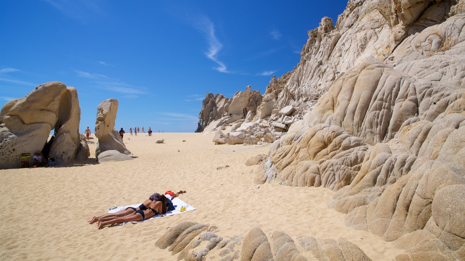 Playa del Amor showing general coastal views, rugged coastline and a beach