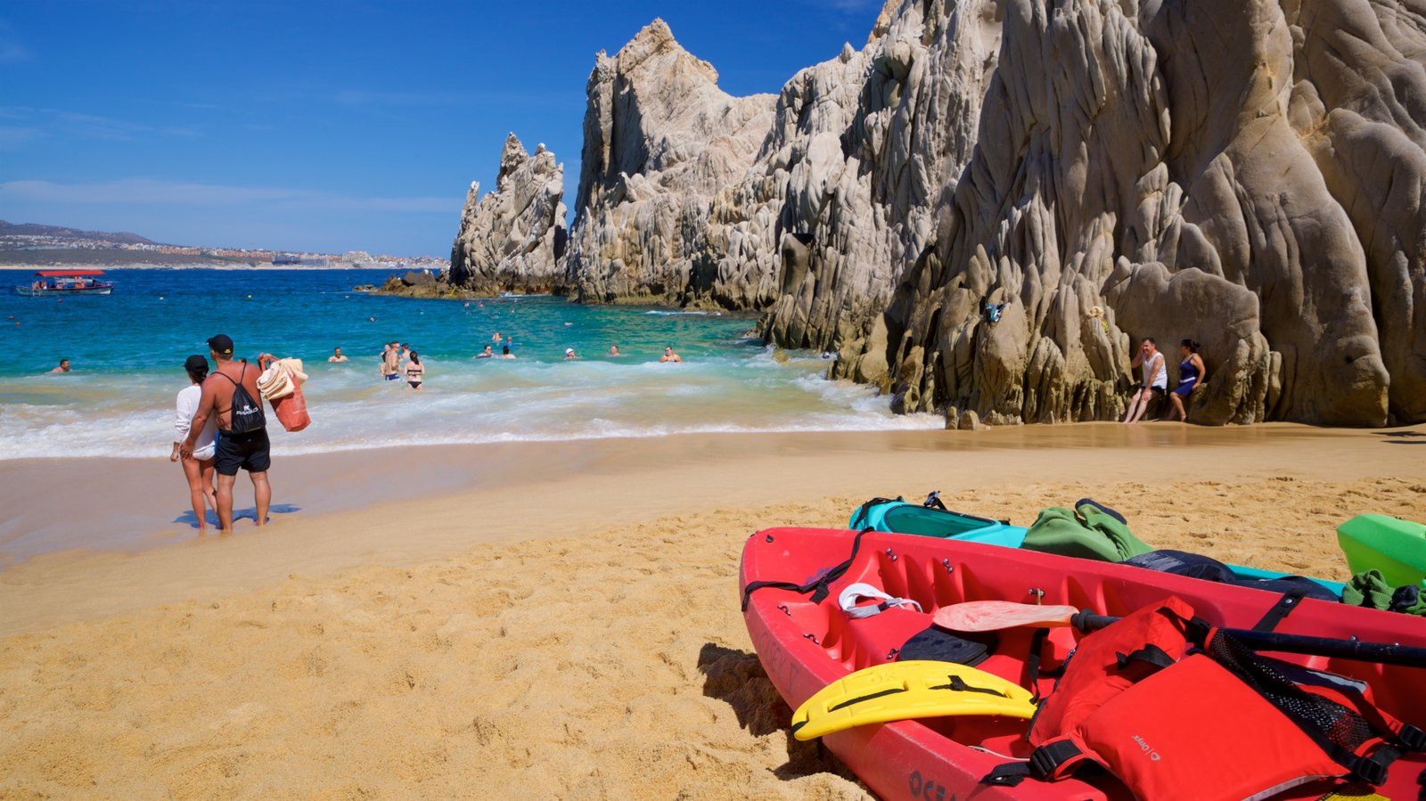 Playa del Amor which includes a sandy beach, rugged coastline and general coastal views