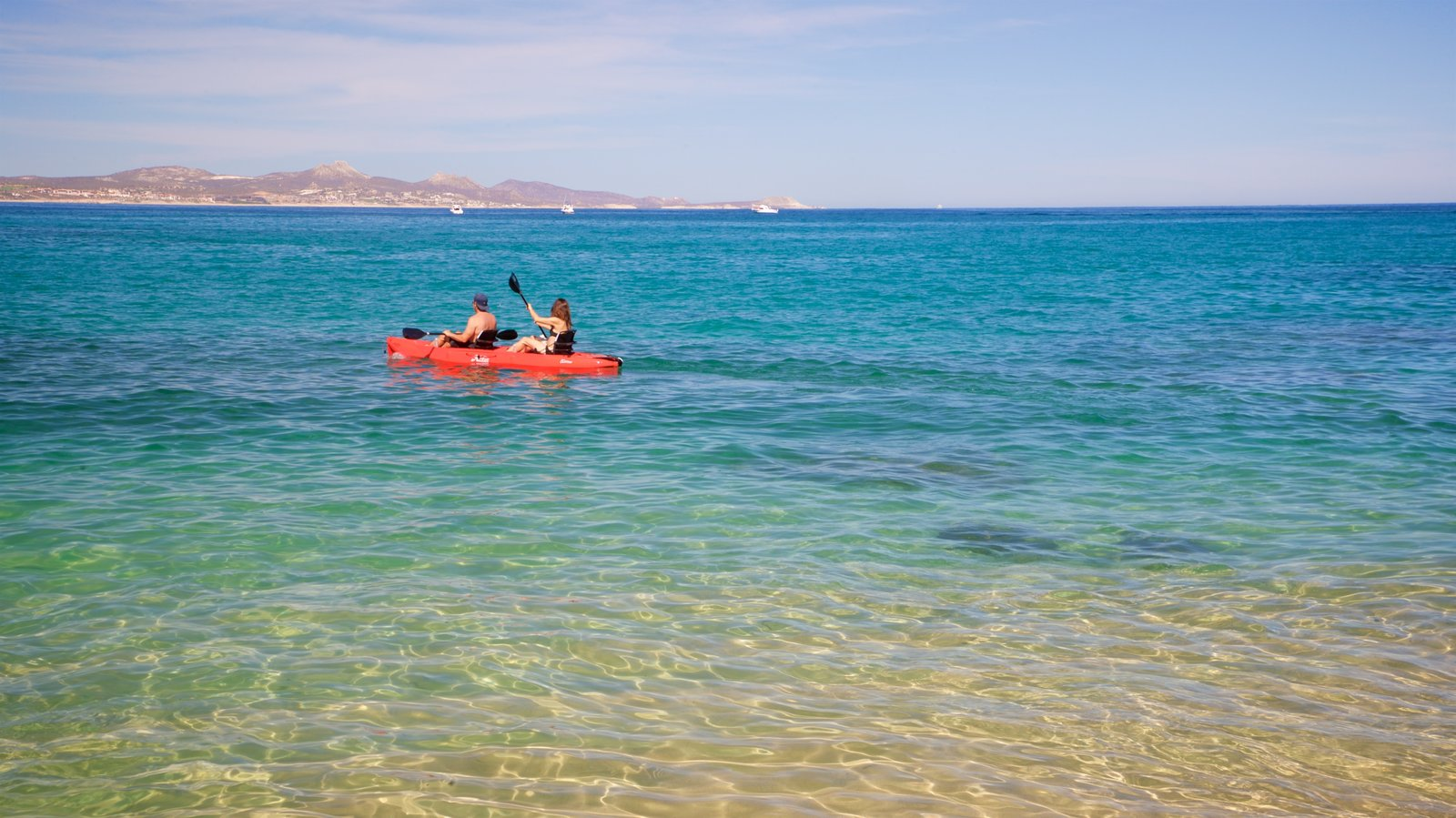 Palmilla Beach showing kayaking or canoeing and general coastal views as well as a couple