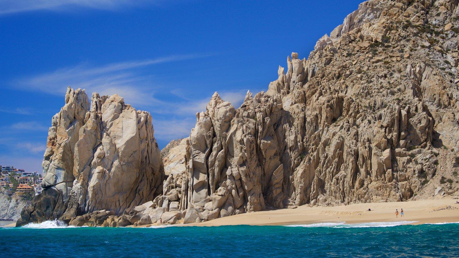 Playa Divorce ofreciendo una playa de arena, vistas generales de la costa y costa escarpada